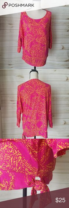 """Chicos Top Super cute top  Orange and pink Has tie on the side 24"""" pit to pit  25"""" Long 95% Rayon  5% Spandex  💛Like 🖒 what you 👀 but not the 💲make me an reasonable offer. Don't be shy 😄💚 Chico's Tops"""