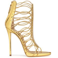 Designed for the season's most stylish parties, these golden metallic leather shoes are a show-stealing pair. The stunning shape is pure Giuseppe Zanotti, while the iridescent material delivers a brilliant update.