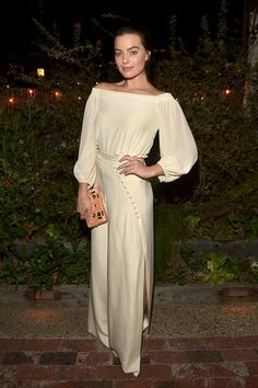 Margot Robbie Wore Billowing Ivory Silk: Last night in L.A., Margot Robbie co-hosted the Carmella Dinner in West Hollywood dressed from head to toe in loose ivory silk.