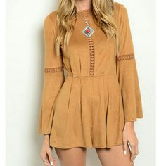 Tan suede romper Long-sleeved suede romper with a slight peek a boo touch in the middle of the chest and on the sleeves. Can be paired with many colors. Awesome piece to have for the Spring.  Ready to ship! Pants Jumpsuits & Rompers