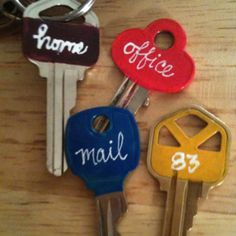 Use nail polish to paint the ends of your keys. The colors alone would work, or add the white nail polish words, if desired.
