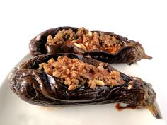 Sheikh el mehshi - Lebanese stuffed eggplants..  Sheikh el Mehshi which consists of small eggplants stuffed with meat and onions and served with rice. There are two ways to make this dish, some people fry the eggplants and others like me, choose the healthy method and just bake it. I always serve this dish with basmati rice, but you can also serve it with plain yogurt too.