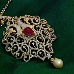 Peacock Diamond Pendant with leafy motifs adorned with rose-cut and curved diamonds, square faceted ruby in the center and south sea pearl drop hanging