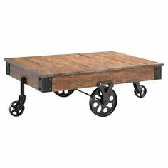 """Bring industrial-inspired flair to your living room or den with this cart-style coffee table, crafted of reclaimed wood and iron and showcasing a wheeled base. Product: Coffee table   Construction Material: Reclaimed wood and ironColor: NaturalFeatures: Cart-styleDimensions: 16.25"""" H x 47"""" W x 31"""" D"""