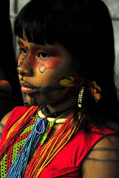 South America | Portrait of a Karajá/Iny girl with traditional painted face, Bananal Island, in the Araguaia Indigenous Park in Tocantins, Amazonian Brazil, Brazil