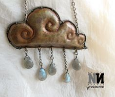 Pendant: rainy cloud. Hand formed copper plate and silver wire, drops are made with labradorite.