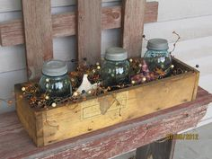 Vintage wood box filled with antique blue Ball mason jars and pip berry garland. $65.00, via Etsy.
