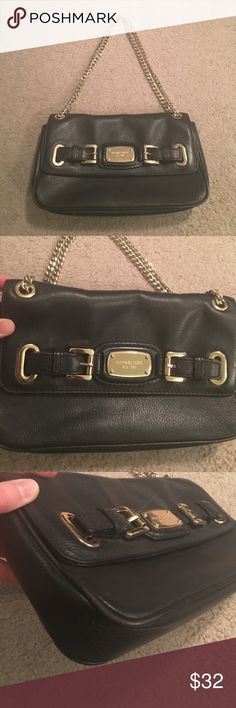 Michael Michael Kors Purse Super cute and good condition! One mark on bottom, some wear to corners. Interior is clean. Strap can be doubled to make short or longer for over the shoulder. MICHAEL Michael Kors Bags