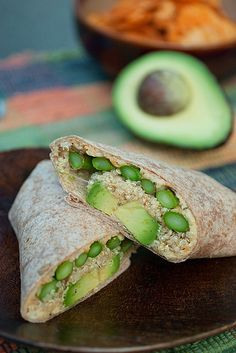 Mmm... Quinoa, Asparagus, and Avocado Wraps. Beautiful and nutritious with a dose of good fats - avocado, olive oil, hummus. I'd leave out the cheddar. Don't think it needs it.