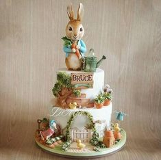 10 BEST EASTER CAKE TUTORIALS Easter is just around the corner. Are you wondering what cake to bake this year? I have a few suggestions for Easter cake tutorials that will blow your mind. From simple and easy to a few worth all the extra effort. Peter Rabbit Cake, Peter Rabbit Birthday, Peter Rabbit Party, Cupcakes, Cupcake Cakes, Beatrix Potter Cake, Carousel Cake, Baby Birthday Cakes, Novelty Cakes