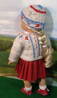 THIS ITEM HAS BEEN RESERVED...THANKS! This classic folkwear-inspired wool-blend sweater and pleated skirt set is perfect for back to school days ahead. The soft oatmeal heather wool- blend cardigan sweater has cables on the fronts and back with decorative embroidery, and closes with mother-of-pearl buttons. A matching beanie-stye hat is included. The red cotton skirt has sharp pleats all around, with a fitted waistband that closes at the back with snaps, with straps anchored by blue…