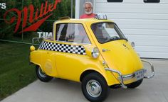 Chuck Miller with his 1957 BMW Isetta 300 taxicab!