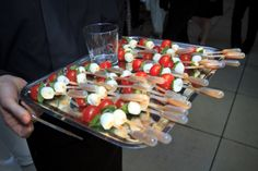 Caprese Shooters with an eye dropper of balsamic glaze