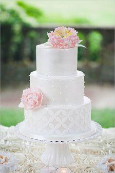 gorgeous tiered white wedding cake #weddingcake #tieredcake #weddingchicks http://www.weddingchicks.com/2014/03/19/seaside-manor-wedding/