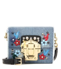 Dolce & Gabbana - Lucia Mini denim shoulder bag - Dolce & Gabbana update their highly covetable Lucia bag in a miniature size with this embellished denim design. The golden hardware and the strap, crafted from black leather, bring a luxe finish. Carry yours next to crisp summer separates. seen @ www.mytheresa.com