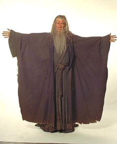 So he def has long sleeves on under, and the robe looks like no more than a big ass shawl.