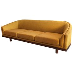 Mid-Century Curved Back Sofa in Mustard Yellow Fabric | From a unique collection of antique and modern sofas at https://www.1stdibs.com/furniture/seating/sofas/