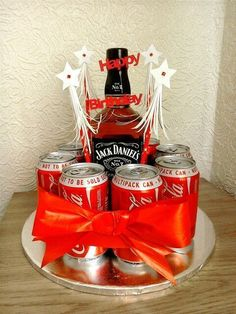 BOOZEDAY CAKE Made this for my son. Used bottle of Jack 8 cans of Coke 3 round oasis holder oasis off-cuts 4 bamboo skewers 11 cake board ribb Creative Birthday Gifts, Diy Birthday, Homemade Gifts, Diy Gifts, Bottle Cake, Diy Gift Baskets, Raffle Baskets, Alcohol Gifts, Candy Bouquet