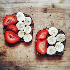 favorite breakfast, Ezekiel bread, Adams crunchy peanut butter, and strawberries...so delish!