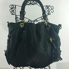 Black leather Vince camuto handbag Has gold hardware with gold Vince camuto emblem in front,  soft leather , used one time,  this is a absolutely beautiful bag, zipper pocket pocket inside 2 smaller pockets inside, magnetic closure Vince Camuto Bags Hobos