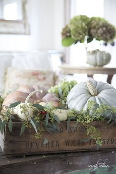 Do you remember last year when I gathered up some of those pretty soft colored pumpkins and some of those little white baby pumpkinsand stacked them up in a traywith just a few sprigs of hydrangea blo