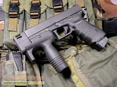 I stumbled across this oddity. It is a Glock 21 with an odd looking muzzle brake and an H&K styled vertical grip typically seen on an MP5K. While I have seen some people try to add a vertical grip onto a Glock before, this one is different. It appears there is a screw that is …   Read More …