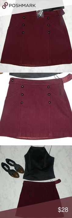 NWT TopShop Maroon Skirt Brand new.  It's missing a button but it comes with replacement button. Topshop Skirts