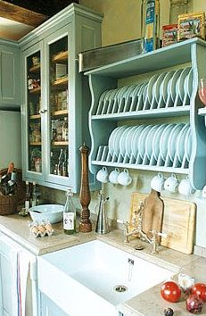Farmhouse sink, blue cupboard and plate rack