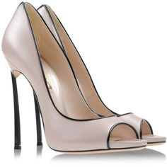Varnished effect. Open toe. Leather sole. Spike heel. Replacement heel tips. Protective shoe bag. Material:Leather