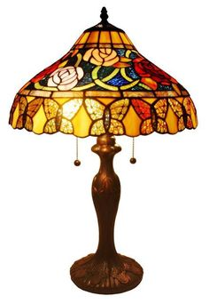 With an elegant metal stem and floral pattern, this lamp honors the traditional look of the coveted lamps of the turn of the 20th century. hand-crafted using the same techniques that were developed by Louis Comfort Tiffany in the early 1900s. Tiffany Style Roses And Butterflies Table Lamp 24 Inches by Rustica House. #myRustica