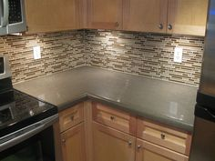 Kitchen backsplash... Hmmm...glass...stone...or combo? Not sure what I like yet.