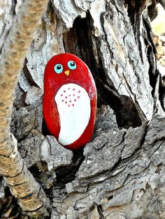 Red bird painted rock by Livingpebbles on Etsy