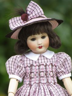 Beatrice Kitty Ghislaine, in a hat by Au Lapin Bleu and a smocked dress by Sarah Zitzer