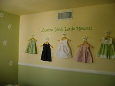 Little Girl Room wall decor   Cute idea for those favorite baby dresses you don't want to pack away let alone give away!!