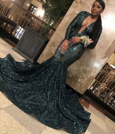 Plunging Emerald Green Sequin Mermaid Prom Gown 2020 This luxury emerald green abstract sequin mermaid dress is perfect for prom Featuring sexy pluning V-neck bodice with sheer long sleeves, exaggerated flare skirt with horsehair detail and long train. Black Girl Prom Dresses, African Prom Dresses, Senior Prom Dresses, Prom Outfits, Prom Dresses Long With Sleeves, Beautiful Prom Dresses, Mode Outfits, Prom Dress Couture, Mermaid Gown Prom