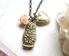 My Favorite Doll Necklace. Dainty salmon pink rose and russian matryoshka doll charm with heart shape locket