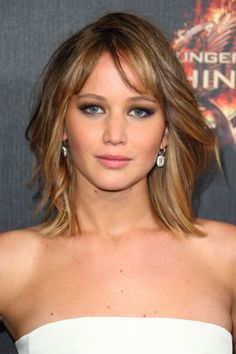 Jennifer Lawrence's lob is accented by side swept bangs.