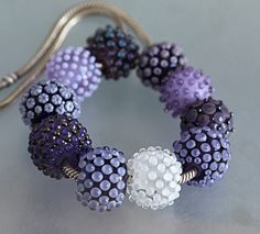 Purple dotted beads by Lezlie B. - these are fun and would be fun to work with.