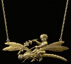 Late 19th Century Art Nouveau 14 Karat Yellow Gold and Diamond Putti Riding a Dragonfly. Signed 14K .