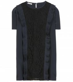 The sheer lace front panel on Miu Miu s navy silk top is softened with a  simple 171a4d9c5af7b