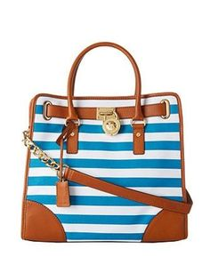 Michael Kors blue and white canvas striped Hamilton. Short handles with long shoulder strap. 2 inside pockets with zipper pocket. Lock has minor wear on it as well as top stripe could use a light cleaning. Very clean and such a statement bag! Fashion Handbags, Tote Handbags, Cross Body Handbags, Leather Handbags, Canvas Handbags, Large Tote, Large Bags, Striped Canvas, Handbags Michael Kors