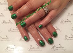 Suspended green glitter gel manicure for Christmas
