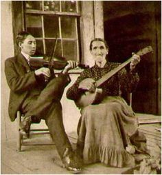 Undated photo of man playing fiddle and woman playing banjo