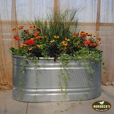Create a Beautiful Stock Tank Planter Use a HW stock tank to build a raised planter. This is an easy, affordable, and low maintenance way to add a rustic look to your garden. Trough Planters, Rustic Planters, Flower Planters, Garden Planters, Garden Beds, Container Flowers, Succulent Containers, Fall Planters, Container Plants