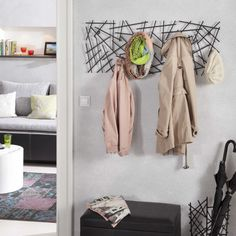 Use Branches And Twine To Make Your Own Wardrobe Rack Decor