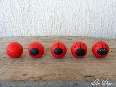 Painted golf balls as garden art.