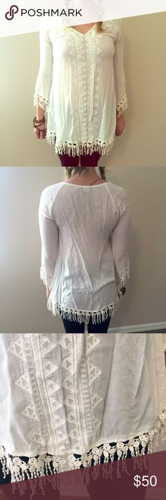 Astr Lace and fringe blouse Lave and fringed cream colored light weight blouse by Astr from Nordstrom. Size Medium. 100% Rayon Nordstrom Tops Tunics