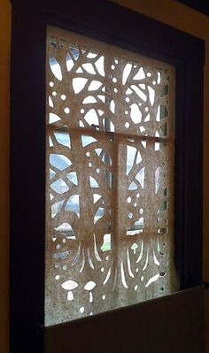 Very unique window coverings!  Paper cutouts...doable if you have patience I think!