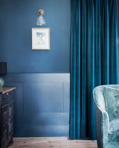 We used sumptuous velvets and a petrol blue colour palette in this living room…