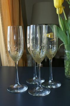 DIY gold confetti champagne glasses - easy way to make your glasses look even more elegant